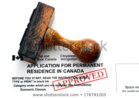 wooden Rubber Stamp  on canadian passport stock photo © flariv