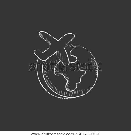 Airplane flying around the world icon drawn in chalk. Stock photo © RAStudio