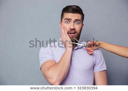 Człowiek patrząc bać kobiet ręce Zdjęcia stock © deandrobot