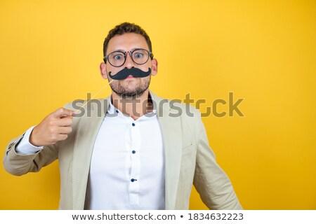 holiday party young man funny glasses stock photo © lunamarina