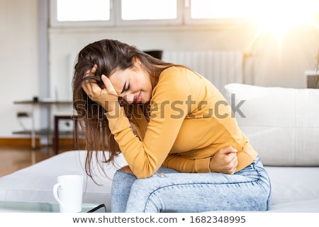 Woman Suffering From Menstruation Pain Stock photo © AndreyPopov