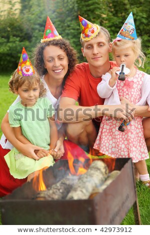 happy family with children near brazier on picnic happy birthda stock photo © paha_l