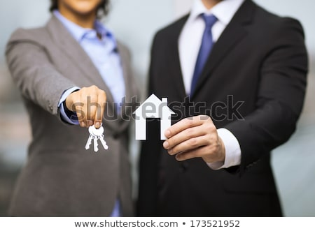 Businessman - real estate concept: giving the keys of new apartment or office Stock photo © scornejor