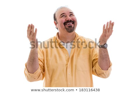 happy man giving thanks to god for a successful outcome smiling and raising his hands with a smile i stock photo © patramansky