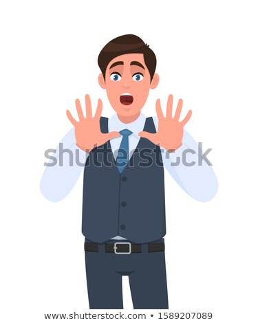 afraid businessman showing frightening gesture stock photo © zurijeta