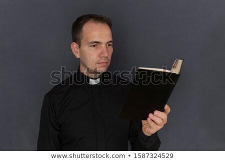 padre · bênção · jovem · mão · livro · luz - foto stock © deandrobot