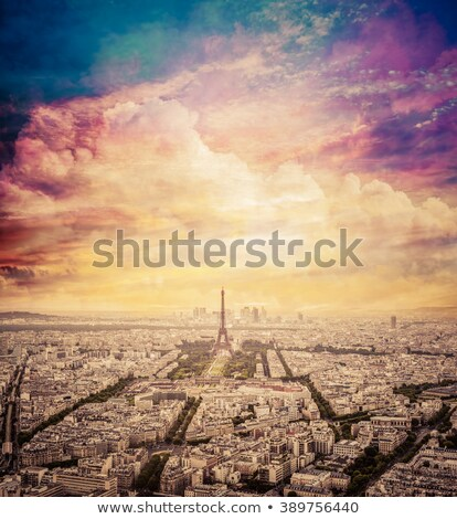 Paris, France skyline with fantastic unique sunset sky. Eiffel Tower in warm light Stock photo © photocreo