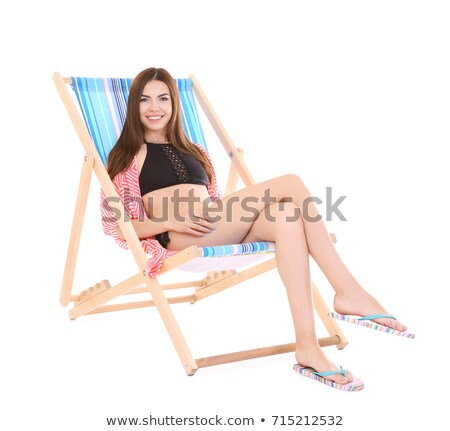 Girl in swimsuit on deck chair Stock photo © bezikus