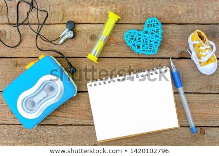Cuaderno pluma reloj de arena mesa negocios Foto stock © dolgachov