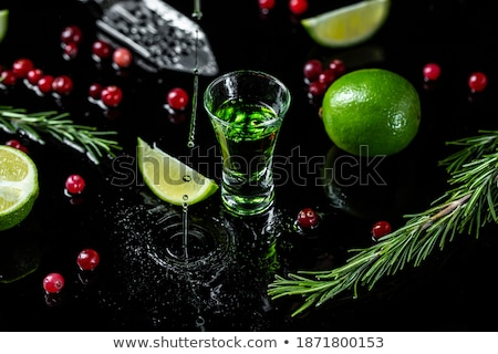 Glass of absinth with lime and sugar cubes Stock photo © Alex9500