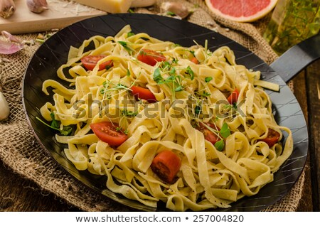 semolina pasta with roasted garlic sprinkled microherbs stock photo © peteer