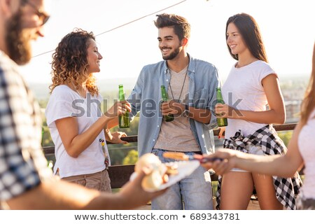 Group of friends standing in circle on barbecue party Stock photo © Kzenon