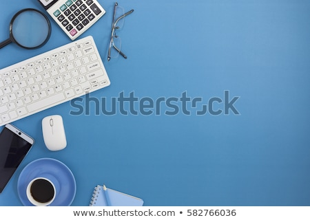 office desk table with calculator pen and glasses stock photo © karandaev