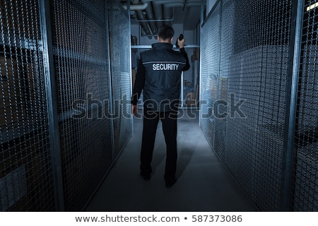Stock photo: Security Guard Standing In The Warehouse