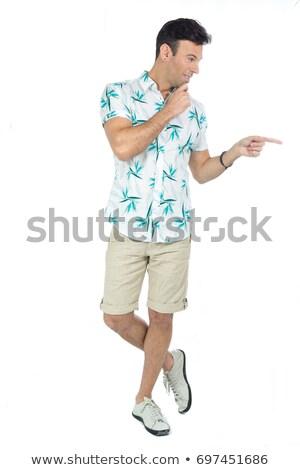 Kaukasisch reiziger wijzend kant jonge vrolijk Stockfoto © RAStudio