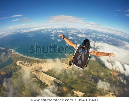 кавказский прыжки парашютом профессиональных женщины падение Сток-фото © RAStudio