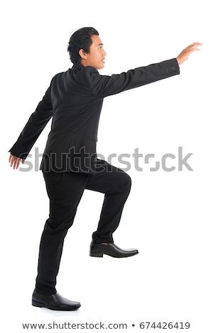 Full body Asian businessman hand grabbing something Stock photo © szefei