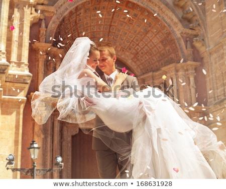 Mosolyog gyönyörű menyasszony kapualj hagyományos fehér Stock fotó © tekso