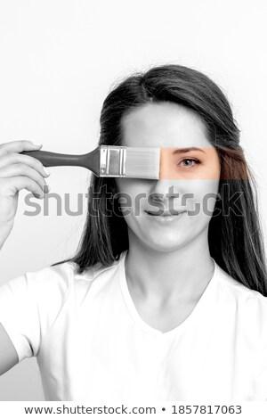Portrait of a smiling fashion designer woman holding paintbrush Stock photo © deandrobot
