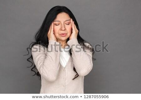 Közelkép idős nő csukott szemmel áll fal Stock fotó © wavebreak_media