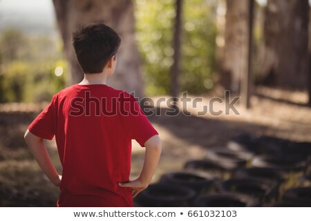 Rear view of boy standing with hands on hip during obstacle course Stock photo © wavebreak_media