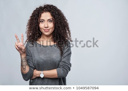 Female hand with tattoos showing two fingers Stock photo © artjazz