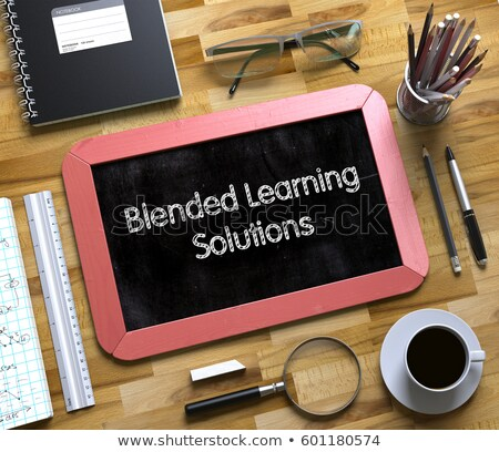 blended learning solutions handwritten on small chalkboard 3d stock photo © tashatuvango