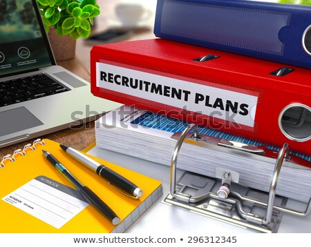 red ring binder with inscription recruitment plan stock photo © tashatuvango