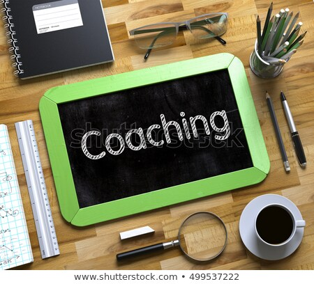Small Chalkboard with Coaching Concept. 3D. Stock photo © tashatuvango