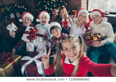 Mother showing child a large Christmas gift Stock photo © dash