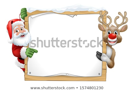 Santa Hat Reindeer Pointing from Behind Sign Stock photo © Krisdog
