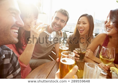 Friends sitting at bar drinking Stock photo © IS2