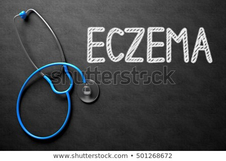 Eczema on Chalkboard. 3D Illustration. Stock photo © tashatuvango