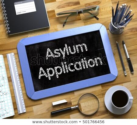 Asylum Application Handwritten on Small Chalkboard. 3D. Stock photo © tashatuvango