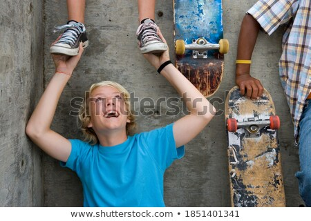 3 children sitting on low wall,  smiling Stock photo © IS2