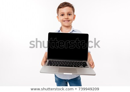 portrait of a cute little kid showing blank screen laptop stock photo © deandrobot