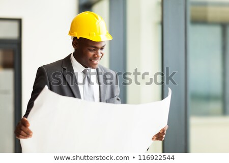 Portrait of a modern young afro american man in helmet Stock photo © deandrobot