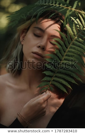 Photo stock: Beautiful Girl Posing In Tropical Forest Close Up Perfect Portrait