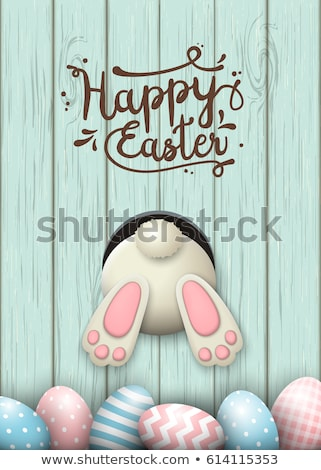 An easter bunny with a pink egg on a white background Stock photo © Zerbor