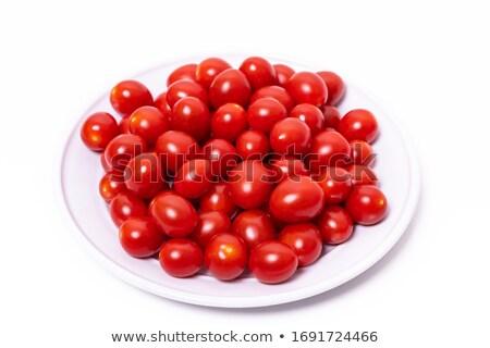 Tazón tomates cherry completo fondo rojo placa Foto stock © thisboy