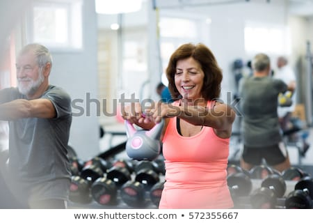 reflection of man exercising with dumbbells stock photo © wavebreak_media