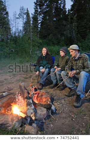 Three people at campsite cooking hot dog Stock photo © IS2
