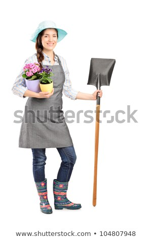 Caucasian smiling girl holding a shovel. Stock photo © RAStudio