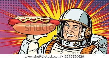 Gülen erkek astronot hediyeler sosisli sandviç sosis Stok fotoğraf © studiostoks