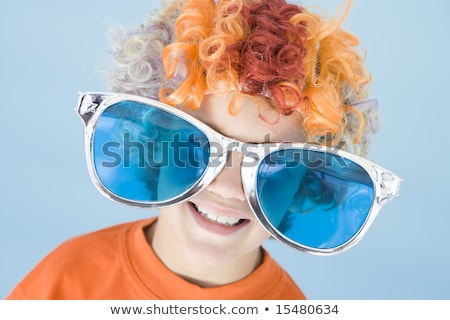 Young boy wearing clown wig and sunglasses smiling Stock photo © monkey_business