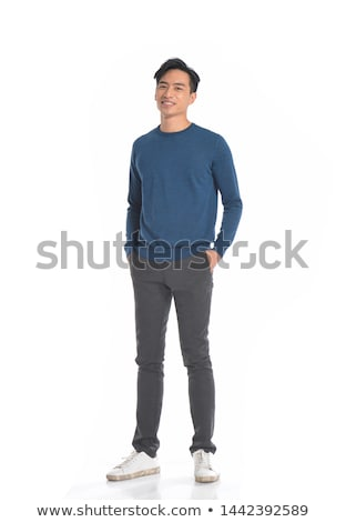 full length portrait of a happy asian man stock photo © deandrobot
