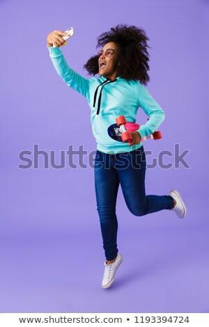 africano · menina · posando · isolado · violeta - foto stock © deandrobot