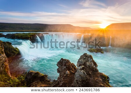 Icelandic waterfall Godafoss at sunset Stock photo © Kotenko