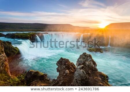 Vízesés naplemente híres turisztikai attrakció Izland tájkép Stock fotó © Kotenko