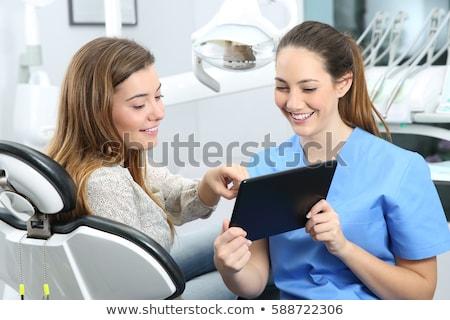 Dentista hablar femenino paciente dentales clínica Foto stock © dolgachov